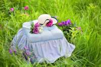 blue tufted tea party bench with hat and flowers
